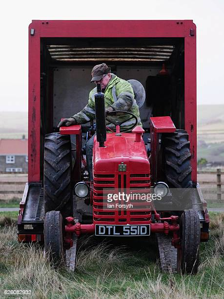 Gordon Sumley from Scarborough unloads his McCormick International tractor ahead of the annual ploughing match on November 27, 2016 in Staithes,...