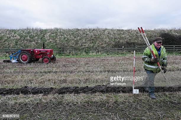 Gordon Sumley from Scarborough walks out to place his rig sticks to help him keep his ploughing straight during the annual ploughing match on...