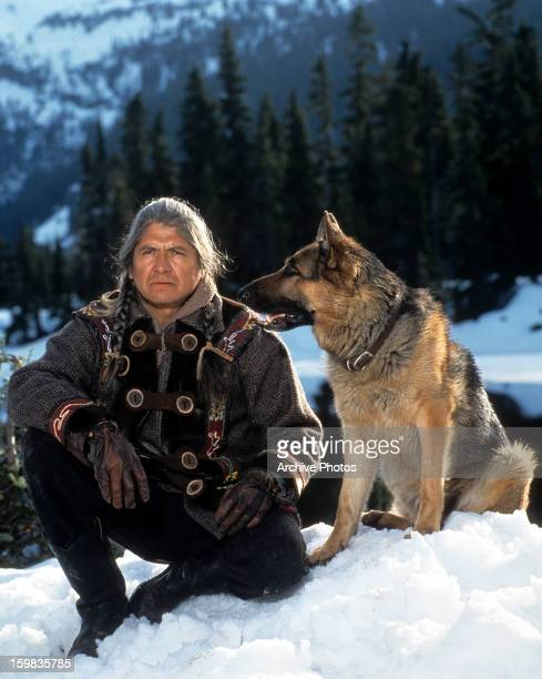 Gordon Tootoosis with his dog Buck in a scene from the film 'Call of the Wild' 1993