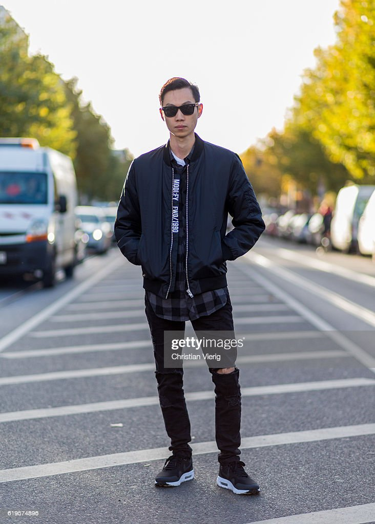 Gordon wears a black bomber jacket, plaid button shirt, sunglasses, black ripped denim jeans, black Nike sneaker on October 31, 2016 in Berlin, Germany.