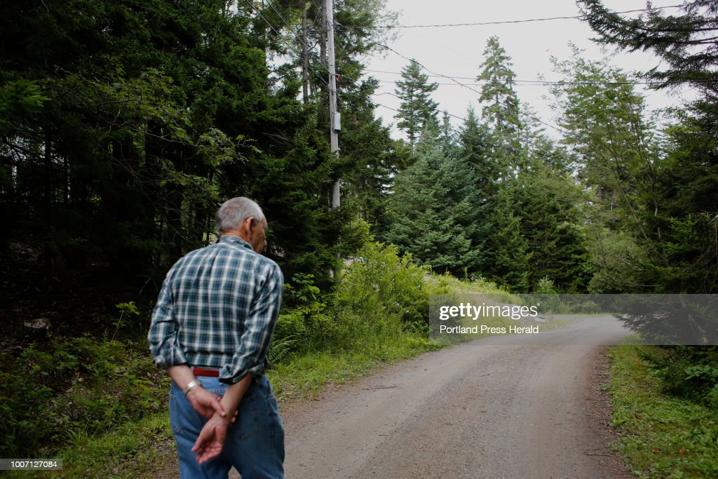 Gordon Weil walks along Firehouse Road near a new utility