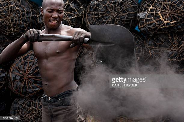 Gordon William gathers char powder from a charcoal depot in Dar es Salaam on March 10 2015 ARTI Energy is a Tanzanian company providing clean energy...