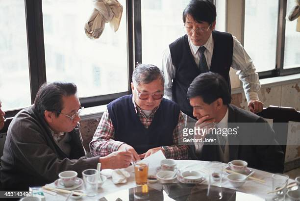 Gordon Wu talks to business partners during as lunch near the construction site for the highway between Hong Kong and Guangzhou in China Wu is a...
