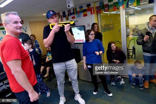 Gordy Gronkowski and Rob Gronkowski play Olympic dart shooting at Boston Children's Hospital February 13 2018 in Boston Massachusetts