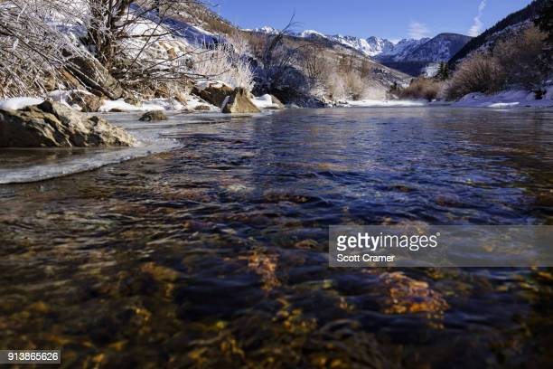 gore creek and mountain range winter vail colorado - gore range stock photos and pictures