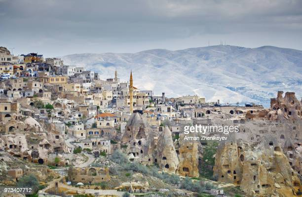goreme town with mosque and residences in rock formations, cappadocia region, turkey - cappadocia stock pictures, royalty-free photos & images