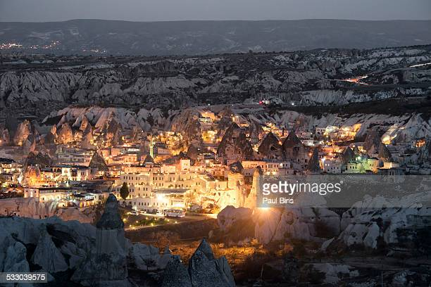 Goreme, View of cliff dwelling and village at nigh