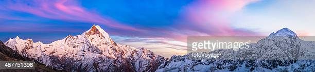 gorgeous alpenglow sunset snowy peaks panorama annapurna sanctuary himalayas nepal - annapurna conservation area stock photos and pictures