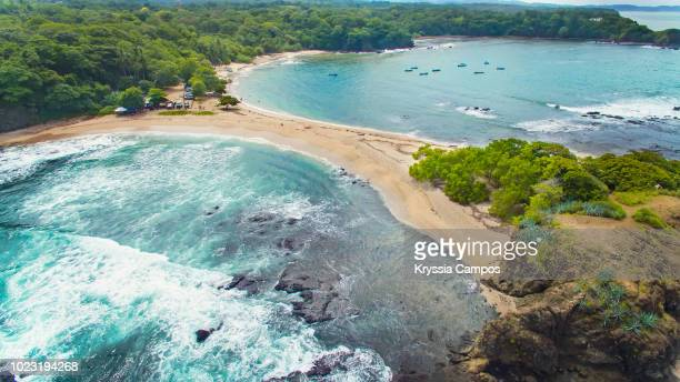 gorgeous beach in costa rica with two fronts of water - costa rica stock pictures, royalty-free photos & images