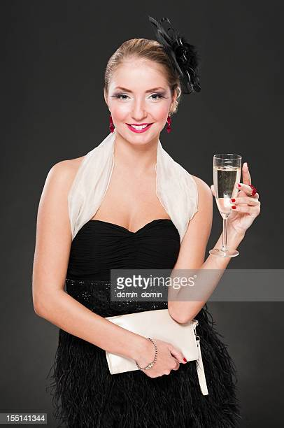 gorgeous blond woman with glass of champagne smiling, evening dress - cocktail dress stock pictures, royalty-free photos & images