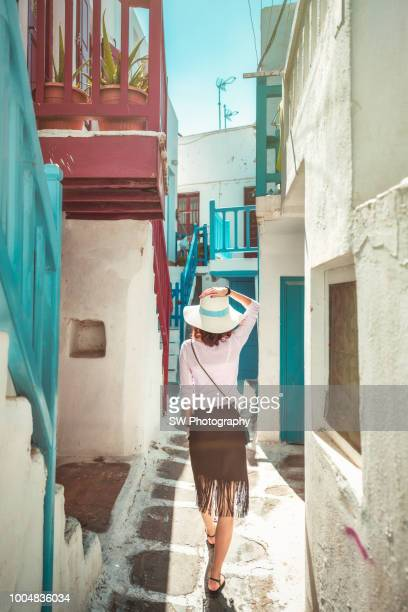 Gorgeous Chinese woman walking in the street of Mykonos