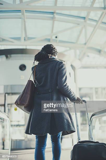 A gorgeous ethnic young adult female is traveling