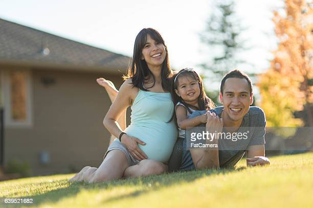Gorgeous ethnic family spending time together outdoors