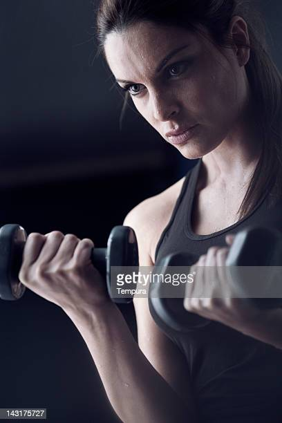 Gorgeous girl practicing fitness in the gym.