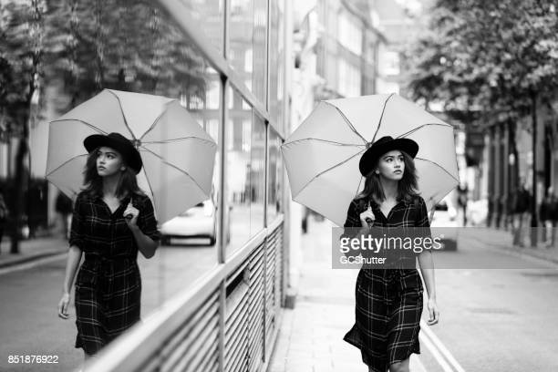 Gorgeous girl walking carrying with an umbrella