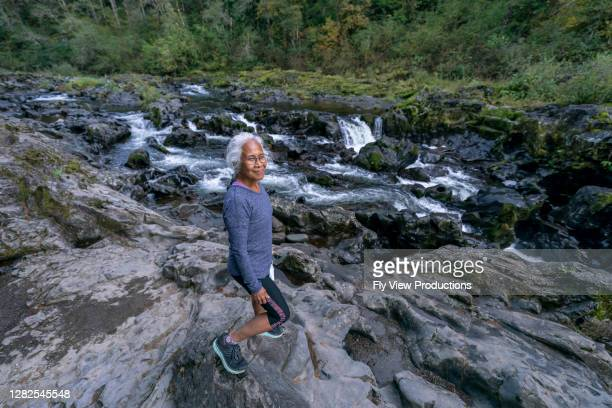 gorgeous hawaiian woman enjoying nature - hawaiian waterfalls stock pictures, royalty-free photos & images
