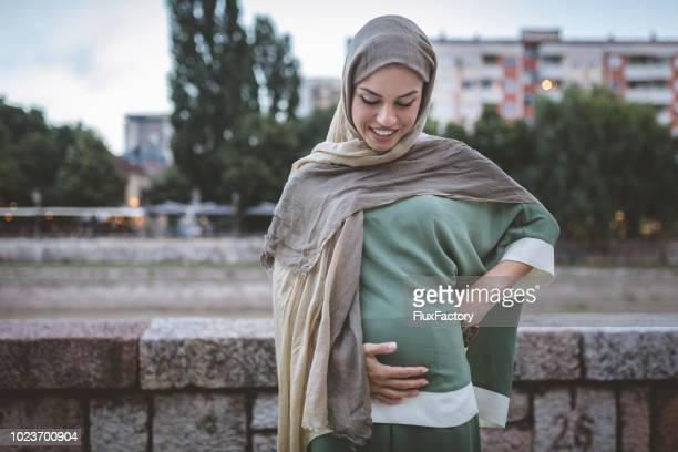 gorgeous pregnant muslim woman - middle eastern culture stock pictures, royalty-free photos & images
