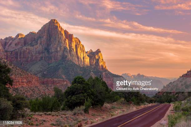 gorgeous sunset over watchman mountain in zion national park, utah, usa - zion national park stock pictures, royalty-free photos & images