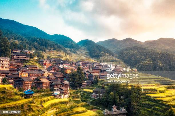 gorgeous sunset view of an old chinese village - village stock pictures, royalty-free photos & images