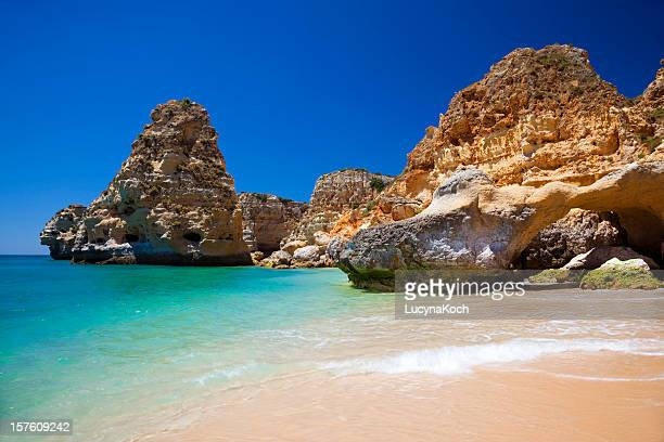 a gorgeous view of the water in praia da marinha - algarve stock photos and pictures