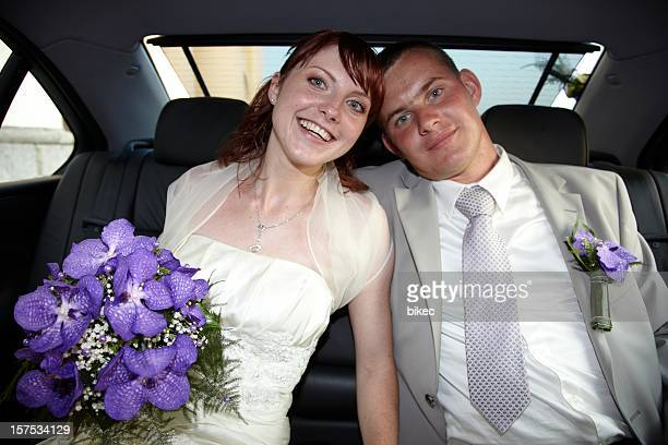 Gorgeous wedding couple (bride and bridegroom) in car