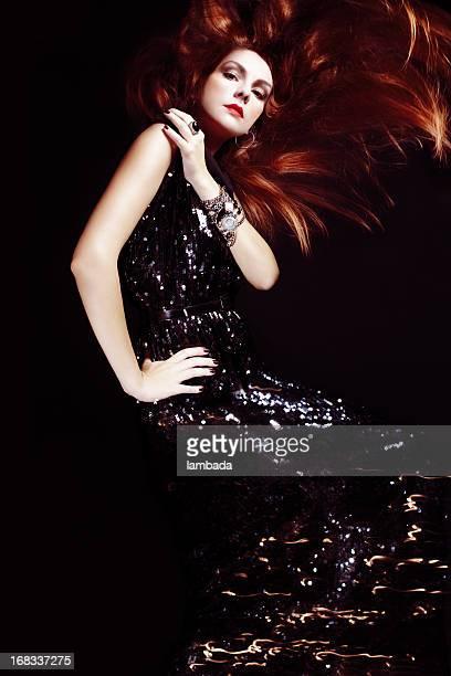 Gorgeous woman in glittering dress