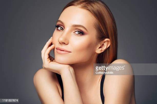 gorgeous woman posing on camera - beautiful woman face stock pictures, royalty-free photos & images