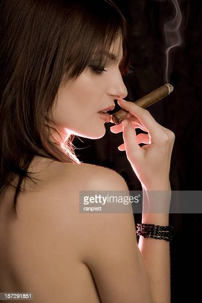 gorgeous woman with cigar - beautiful women smoking cigars stock photos and pictures
