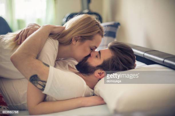 gorgeous young couple kissing in the bed in the morning - love you stock photos and pictures