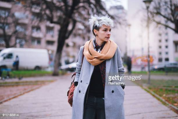 gorgeous young lady in the city - genderblend stock pictures, royalty-free photos & images