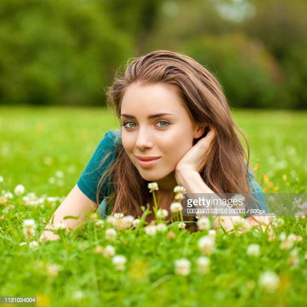 Gorgeous Young Pretty Woman Relaxing In Summer Park