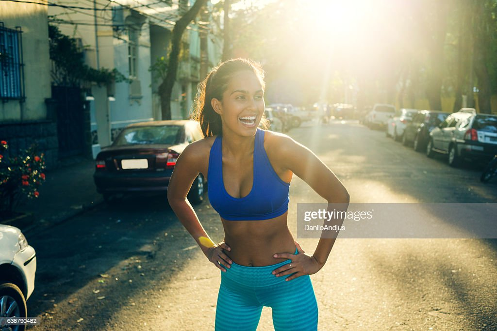 gorgeous young woman stretching after workout : Foto stock