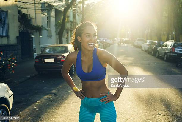 gorgeous young woman stretching after workout - sexy young women stock pictures, royalty-free photos & images