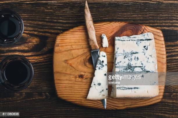 Gorgonzola cheese on wooden cutting board