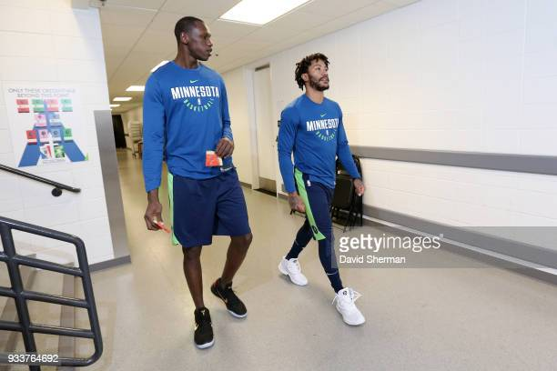 Gorgui Dieng and Derrick Rose of the Minnesota Timberwolves arrive before the game against the Houston Rockets on March 18 2018 at Target Center in...