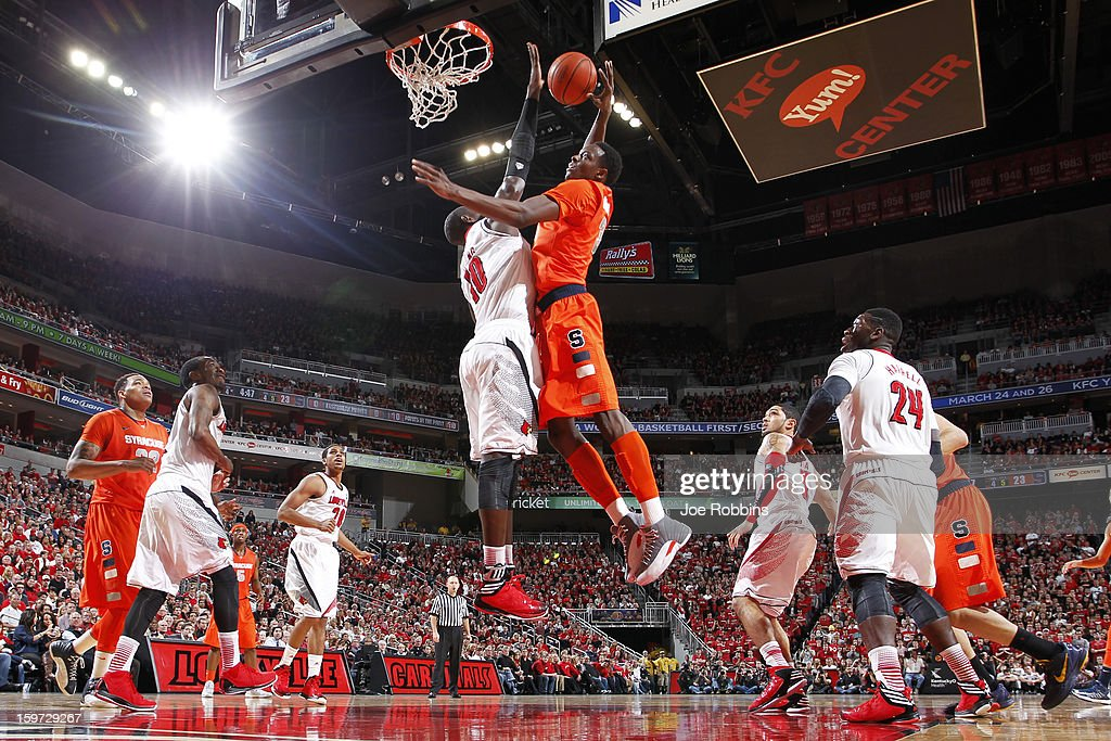 Gorgui Dieng #10 of the Louisville Cardinals blocks a shot against Jerami Grant #3 of the Syracuse Orange during the game at KFC Yum! Center on January 19, 2013 in Louisville, Kentucky.