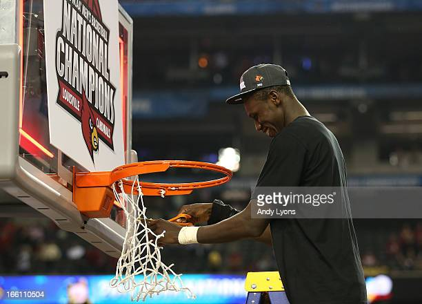 Gorgui Dieng of the Louisville Cardinals cuts down the net after they won 8276 against the Michigan Wolverines during the 2013 NCAA Men's Final Four...
