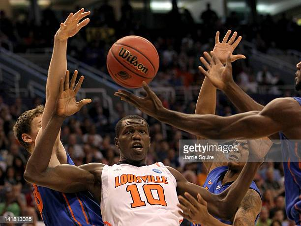 Gorgui Dieng of the Louisville Cardinals goes for the ball along with Erik Murphy of the Florida Gators in the first half during the 2012 NCAA Men's...