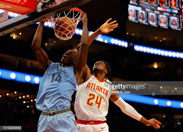 Gorgui Dieng of the Memphis Grizzlies dunks against Bruno Fernando of the Atlanta Hawks in the second half at State Farm Arena on March 02, 2020 in...