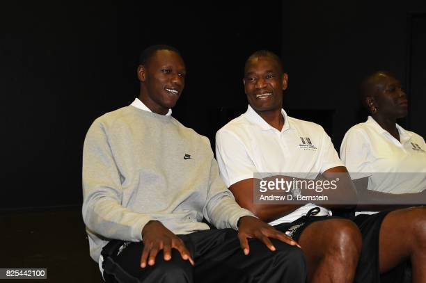 Gorgui Dieng of the Minnesota Timberwolves and NBA Legend Dikembe Mutombo chats during a life skills event during the Basketball Without Borders...