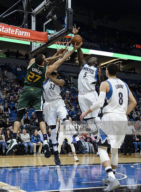 Gorgui Dieng of the Minnesota Timberwolves blocks a shot by Rudy Gobert of the Utah Jazz during the game on January 7 2017 at the Target Center in...