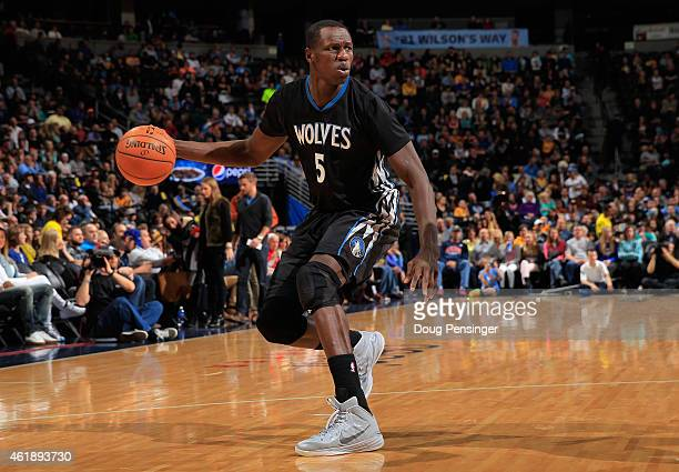 Gorgui Dieng of the Minnesota Timberwolves controls the ball against the Denver Nuggets at Pepsi Center on January 17 2015 in Denver Colorado The...