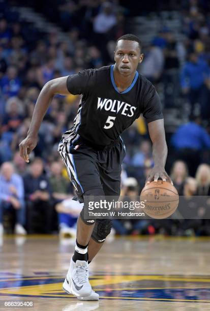 Gorgui Dieng of the Minnesota Timberwolves dribbles the ball on offense against the Golden State Warriors during an NBA basketball game at ORACLE...