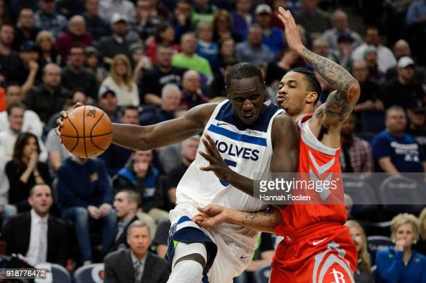 Gorgui Dieng of the Minnesota Timberwolves drives to the basket against Gerald Green of the Houston Rockets during the game on February 13 2018 at...