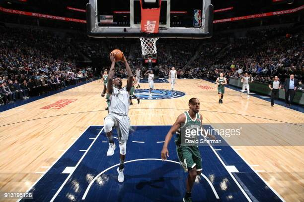 Gorgui Dieng of the Minnesota Timberwolves drives to the basket against the Milwaukee Bucks on February 1 2018 at Target Center in Minneapolis...
