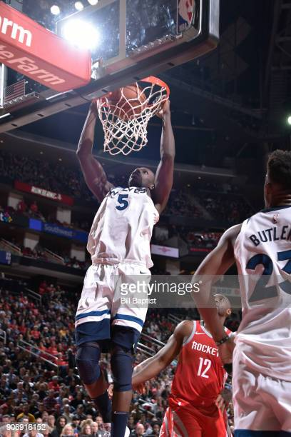 Gorgui Dieng of the Minnesota Timberwolves dunks the ball against the Houston Rockets on January 18 2018 at the Toyota Center in Houston Texas NOTE...