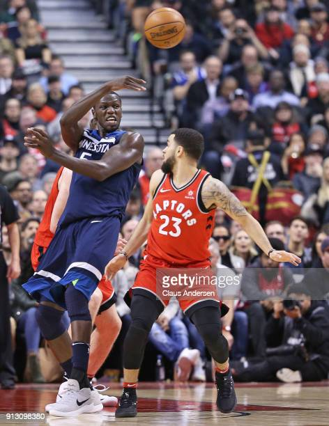 Gorgui Dieng of the Minnesota Timberwolves fires a pass over Fred VanVleet of the Toronto Raptors in an NBA game at the Air Canada Centre on January...