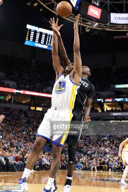 Gorgui Dieng of the Minnesota Timberwolves goes for a rebound against Kevon Looney of the Golden State Warriors during the game on March 10 2017 at...