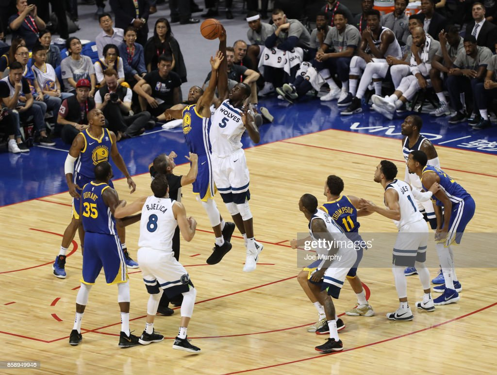 Gorgui Dieng #5 of the Minnesota Timberwolves goes for the ball against Andre Iguoadala #9 of the Golden State Warriors as part of the 2017 Global Games - China on October 8, 2017 at the Mercedes Benz Arena in Shanghai, China.