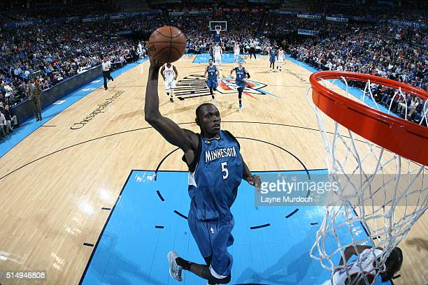 Gorgui Dieng of the Minnesota Timberwolves goes up for a dunk against the Oklahoma City Thunder on March 11 2016 at Chesapeake Energy Arena in...